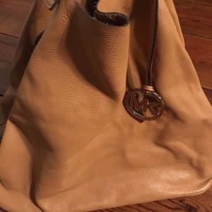 Michael Kors reversible luggage tote